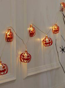 Grimacing pumpkins string lights, $12, simons.ca